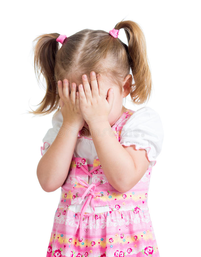 Scared crying or playing bo-peep girl hiding face stock images