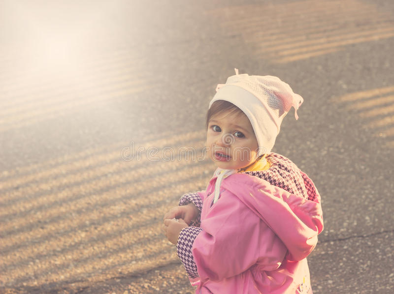 Scared cute little baby girl stock photo