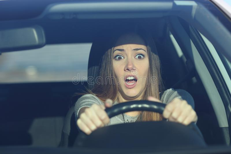 Scared driver driving a car before an accident stock photos