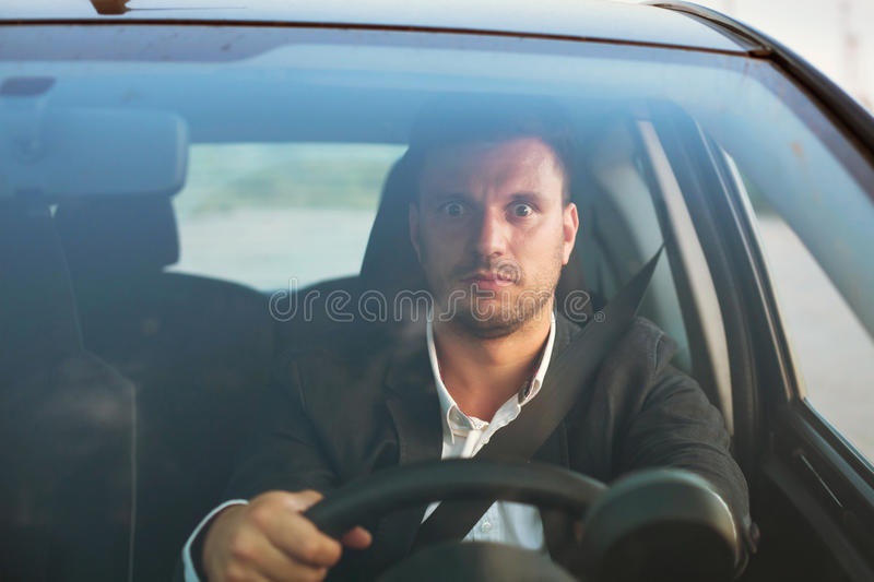 Scared driver. Shocked driver inside the car stock photos