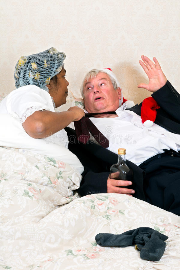 Scared drunk with angry wife royalty free stock photos