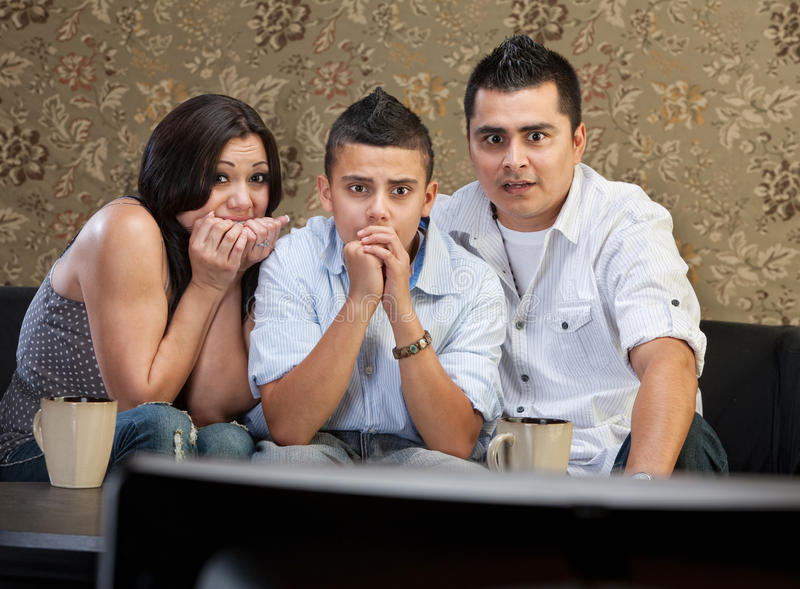 Download Scared Family Watching TV stock image. Image of partner - 33028991