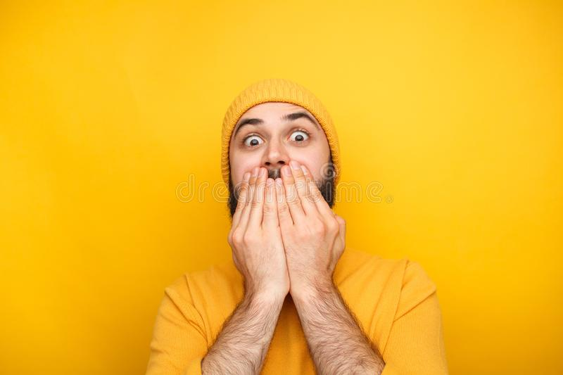 Frightened man in yellow clothes royalty free stock photo