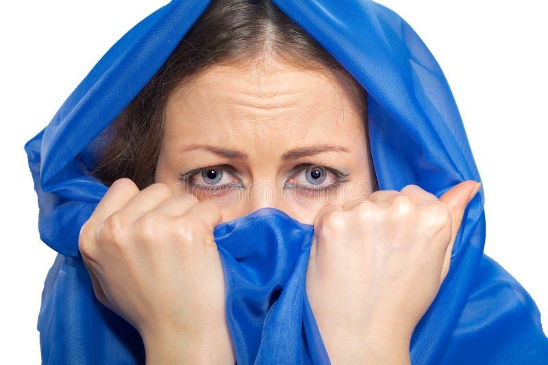 Scared girl in green hijab