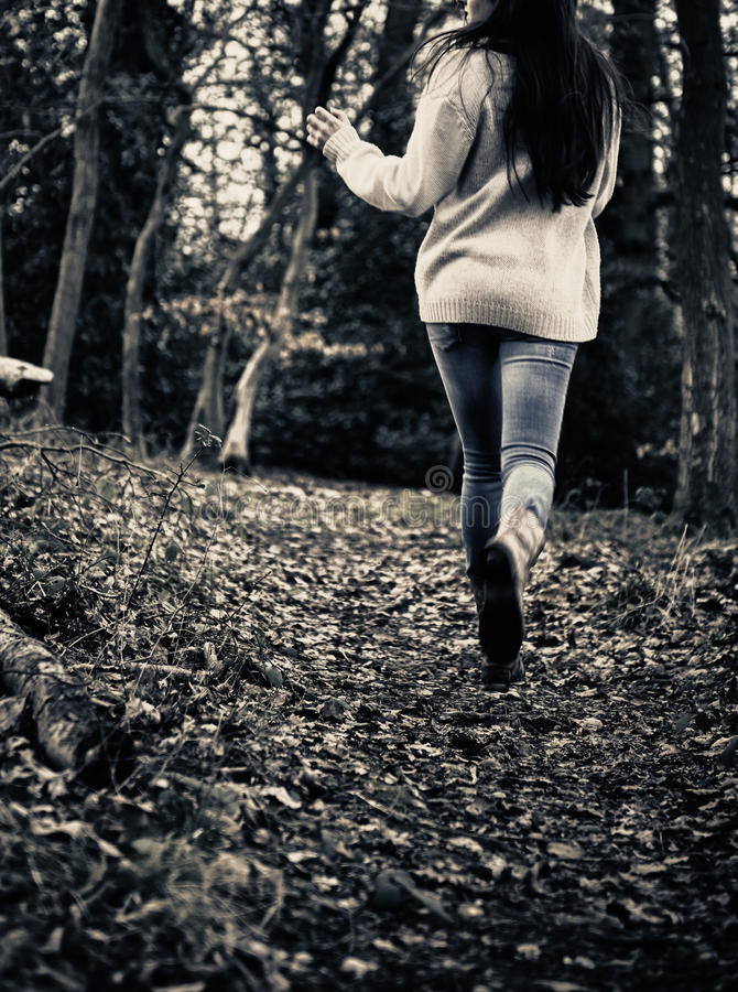 Scared girl running royalty free stock images