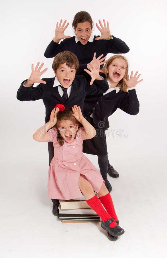 Scared kids. A group of schoolchildren with panic expressions royalty free stock image
