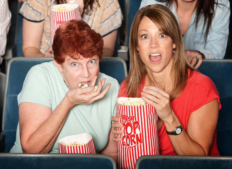 Scared Ladies in Theater royalty free stock photo