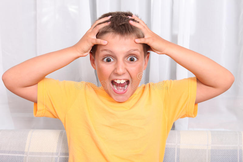 Download Scared little boy stock photo. Image of fear, hand, person - 20385654