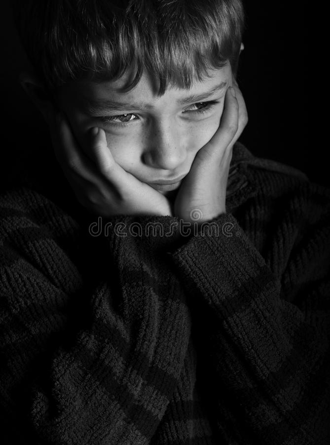 Scared And Lonely Blonde Boy Stock Photo
