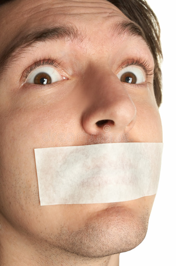 Scared man with gag. Isolated over white stock image