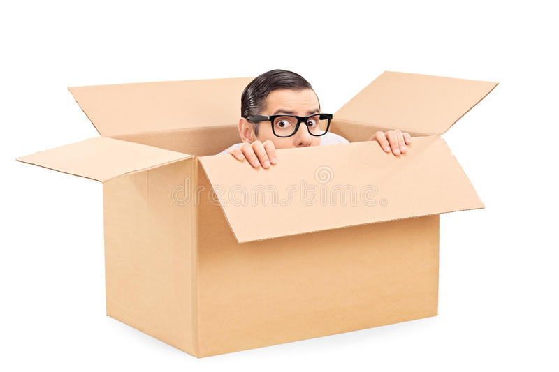 scared man hiding in a carton box stock photo image of. Black Bedroom Furniture Sets. Home Design Ideas