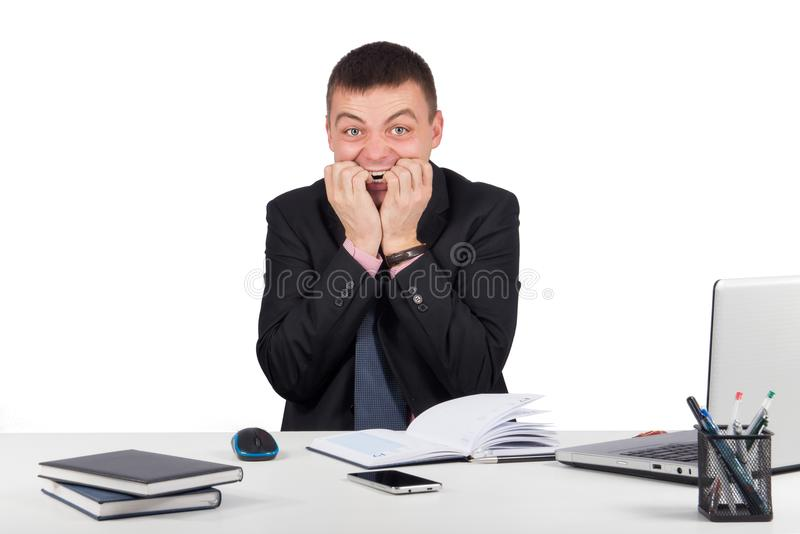Scared manager biting his nails stock photos