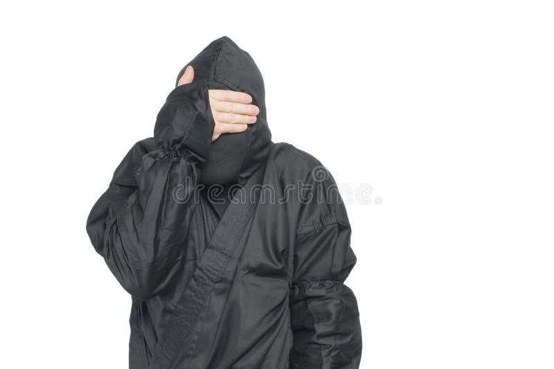 A scared ninja. A ninja warrior feeling scared stock images