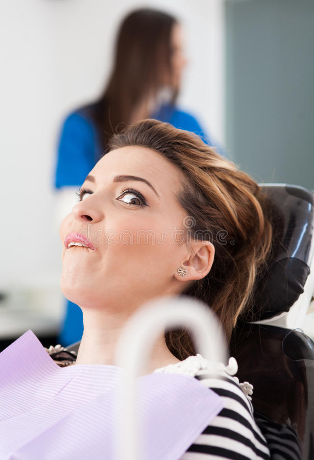 Scared Patient At Dentist Stock Photo