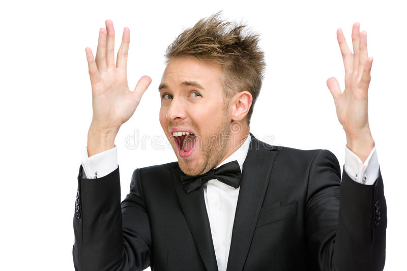 Scared and screaming business man with hands up stock photography