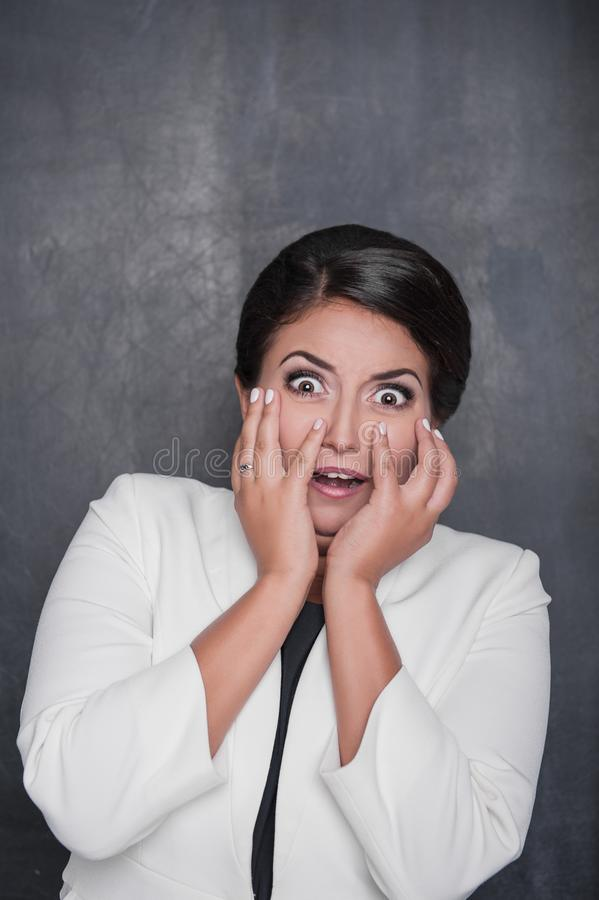 Scared screaming woman on chalkboard background stock photos