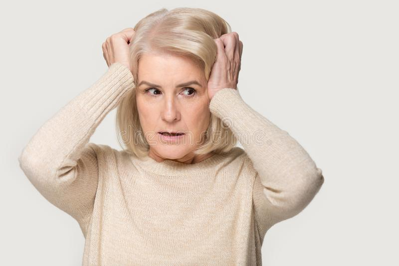 Sacred mature woman feel terrified freaking out stock photo