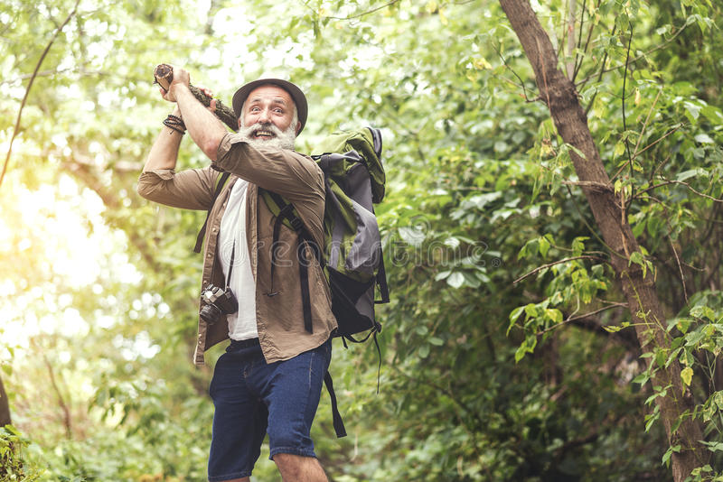 Scared senior male tourist in wild nature royalty free stock photography