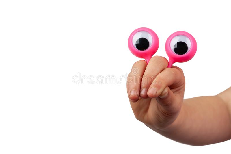Scared serious cartoonish face with googly eyes. Scared serious cartoonish face with googly eyes hand gesture isolated on white background with copy space stock photo