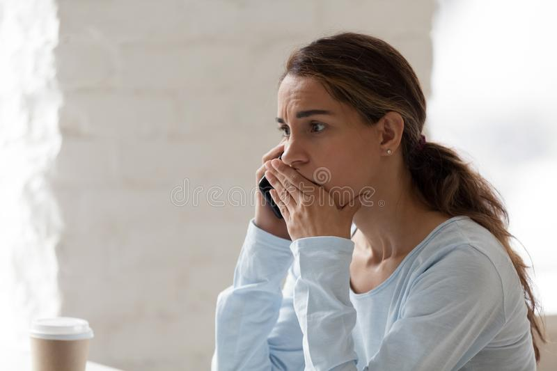 Scared shocked woman talking on phone, receiving bad news royalty free stock photos