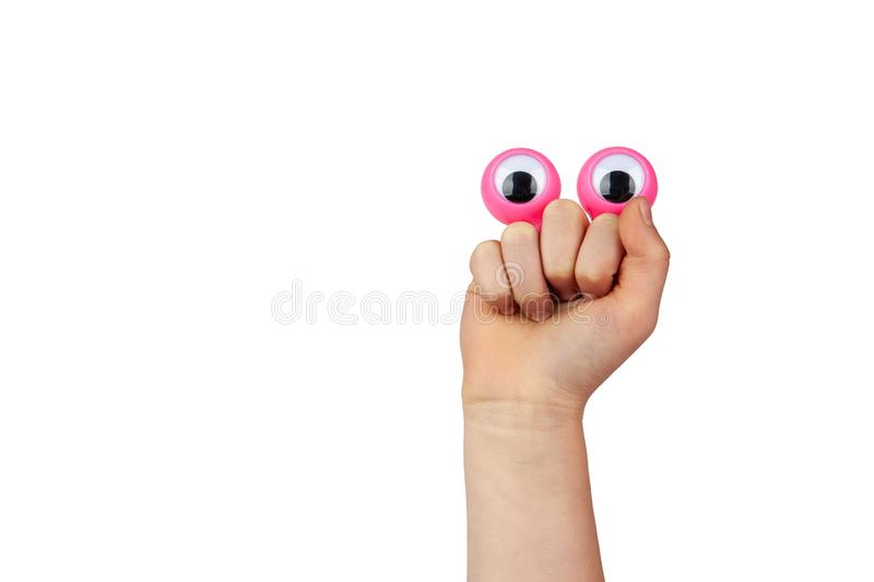 Scared but smiling funny cartoonish face made by googly eyes. Scared but smiling funny cartoonish face made by googly eyes and childs hand isolated on white royalty free stock photo