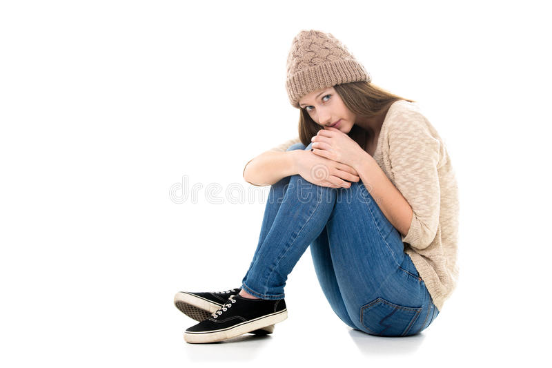 Scared teenage girl curled-up stock photography