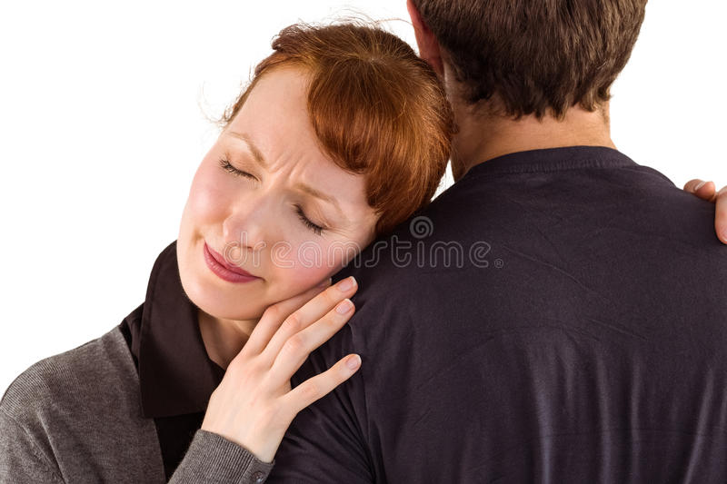 Scared woman holding onto man. Scared women holding onto men on white background stock photography