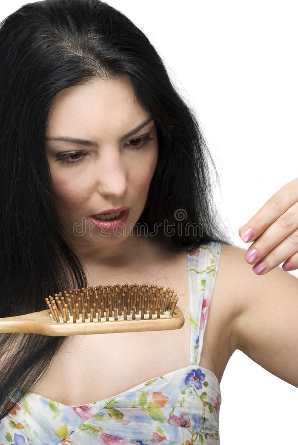 Free Scared Woman Lose Hair On Hairbrush Royalty Free Stock Photo - 12714045