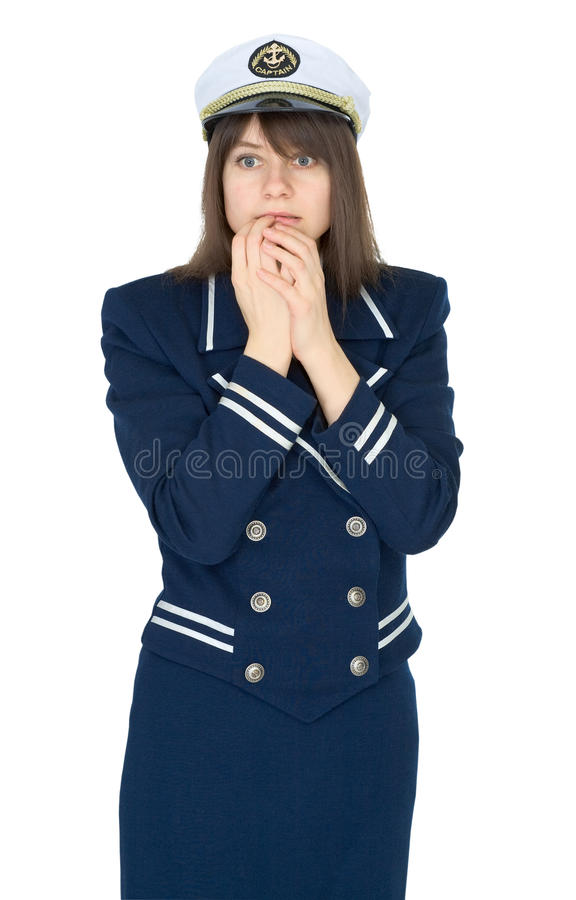Scared woman in uniform of sea captain royalty free stock image