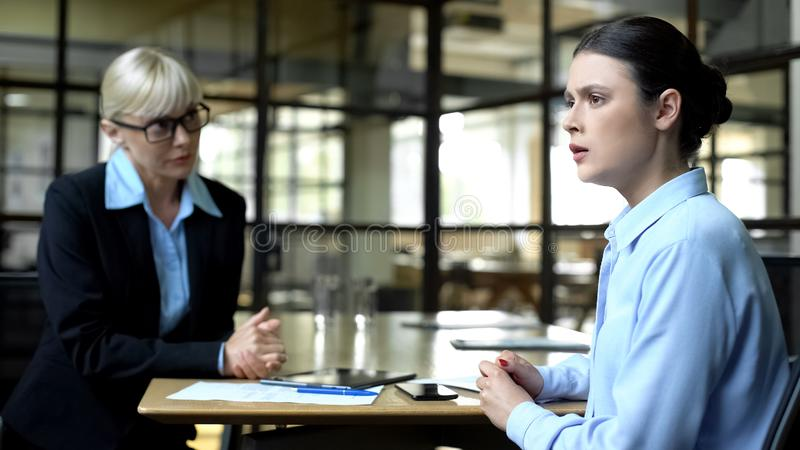 Scared woman at job interview with strict lady boss, business career development. Scared women at job interview with strict lady boss, business career royalty free stock photos