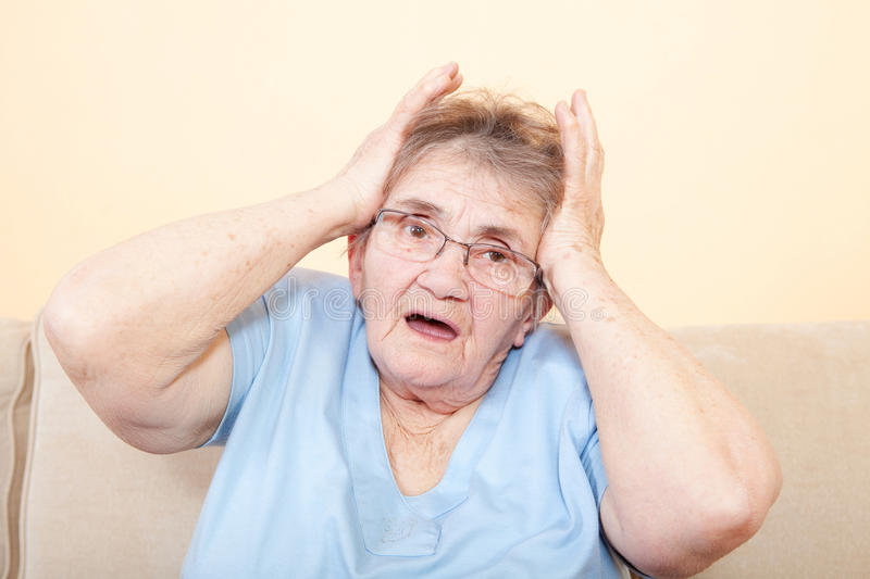Scared and worried senior lady royalty free stock photography