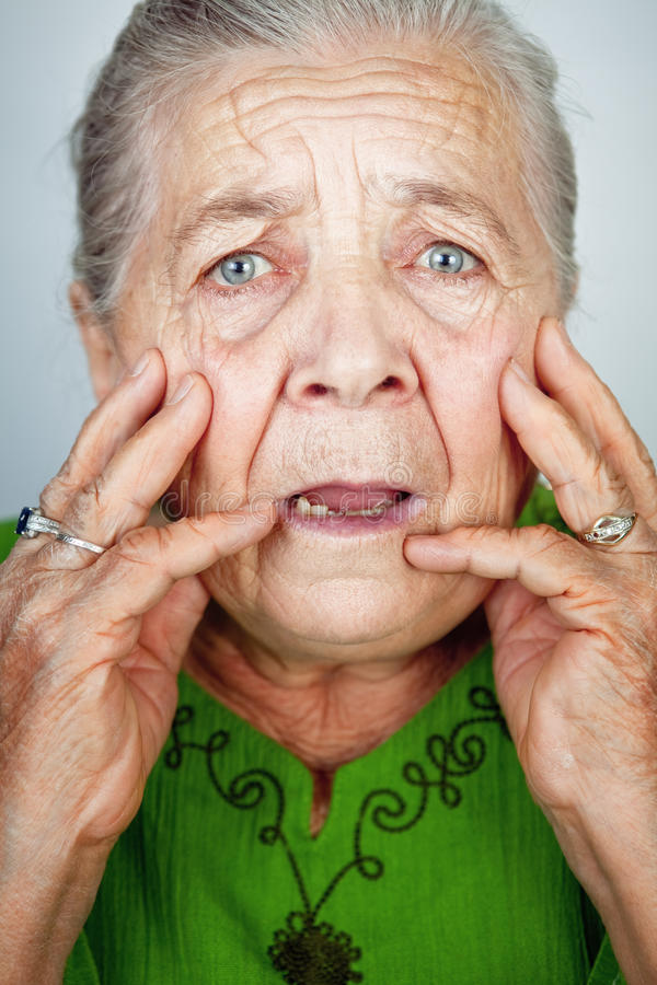 Scared and worried senior woman with wrinkles stock images