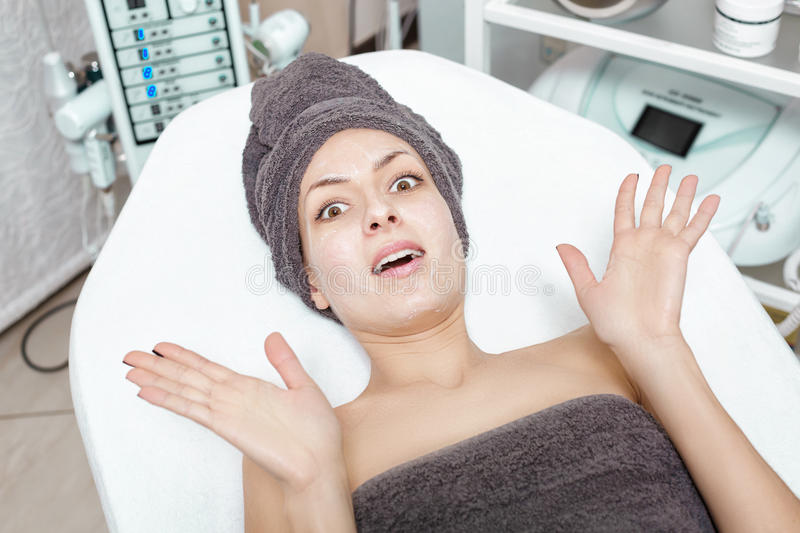 Scared young brunette woman waiting for Spa treatment in Spa salon. cosmetology stock photos