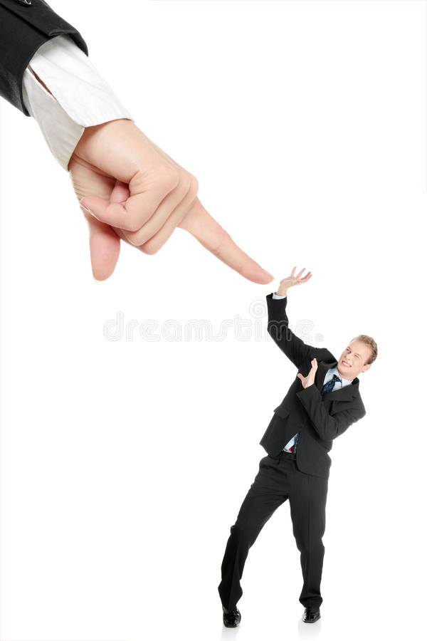 Scared young businessman afraid of big hand stock images