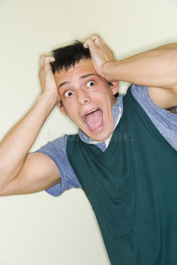 Scared young man stock image