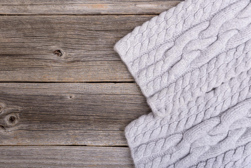 Scarf on wooden boards. Winter scarf on the background of the old wooden boards stock photography