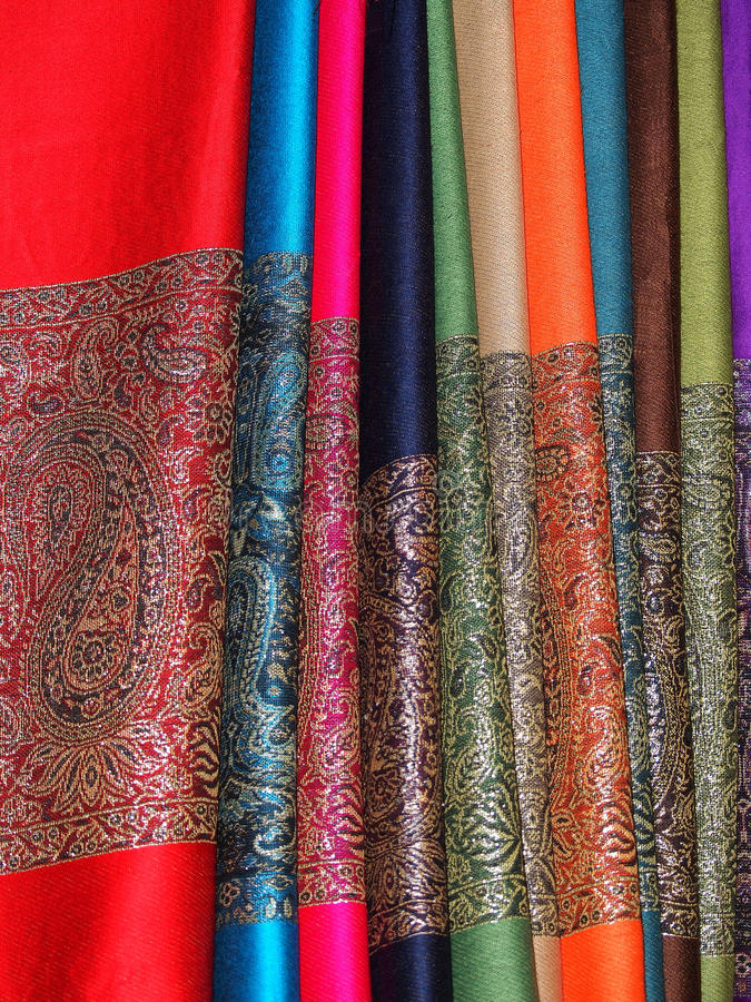 Scarfs. Pile of gentle folded shawls (scarfs)hanging at the market in Marrakesh royalty free stock images