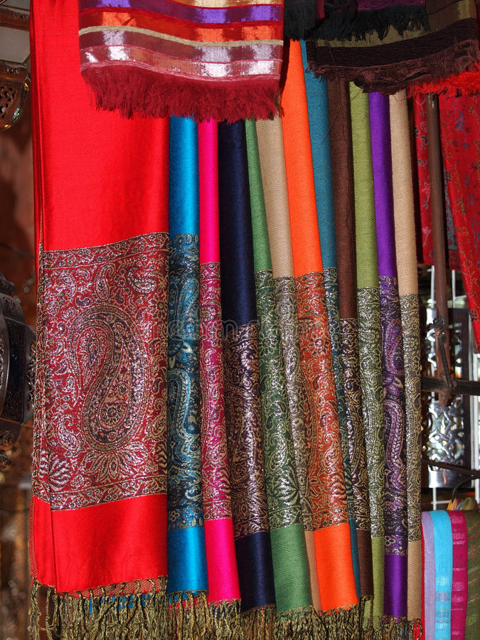 Scarfs. Pile of gentle folded shawls (scarfs) at the market in Marrakesh royalty free stock photography