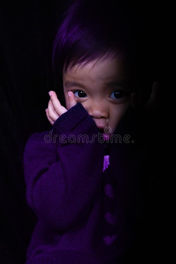 Free Scaring Asia Baby Girl In Purple Stock Images - 112162814