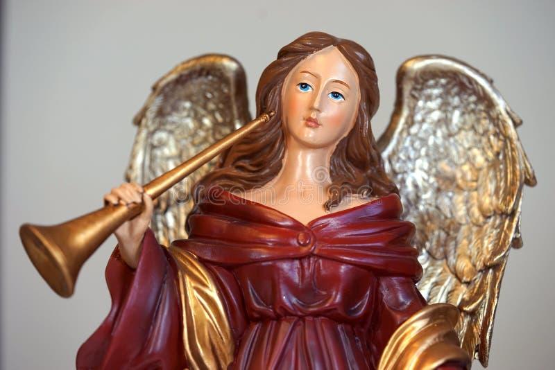 Scarlet angel musician stock image
