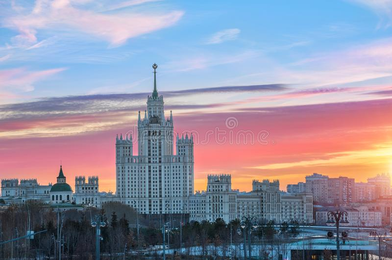 Scarlet clouds of dawn over a high-rise on Kotelnicheskaya. The scarlet clouds of autumn dawn over a high-rise on Kotelnicheskaya Embankment in Moscow stock photos