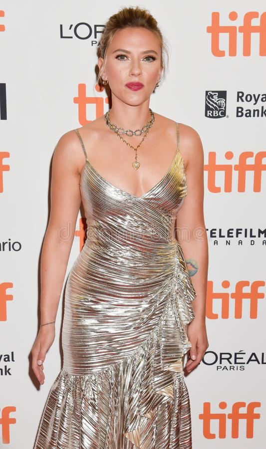 Scarlett Johansson on red carpet for Jojo Rabbit movie premiere at TIFF. Beautiful actress blond celebrity star with natural beauty. Rodarte Fall 2019 dress royalty free stock photo