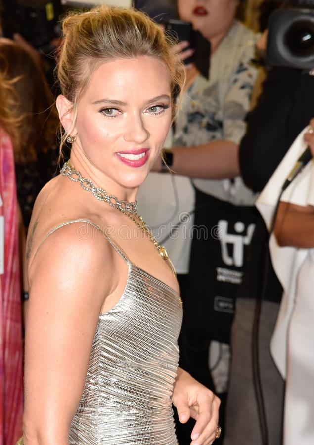 Scarlett Johansson on red carpet for Jojo Rabbit movie premiere at TIFF. Beautiful actress blond celebrity star with natural beauty. Rodarte Fall 2019 dress royalty free stock images