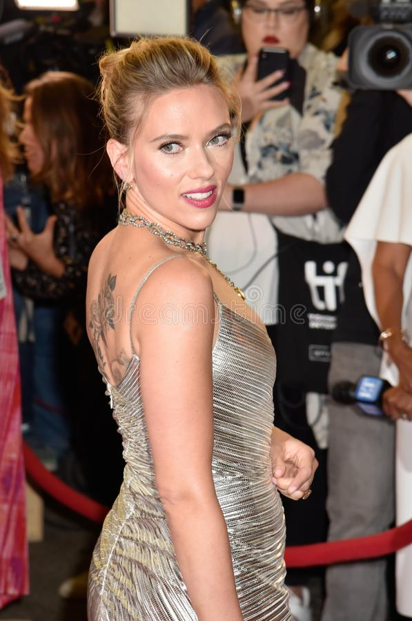 Scarlett Johansson on red carpet for Jojo Rabbit movie premiere at TIFF. Beautiful actress blond celebrity star with natural beauty. Rodarte Fall 2019 dress royalty free stock image