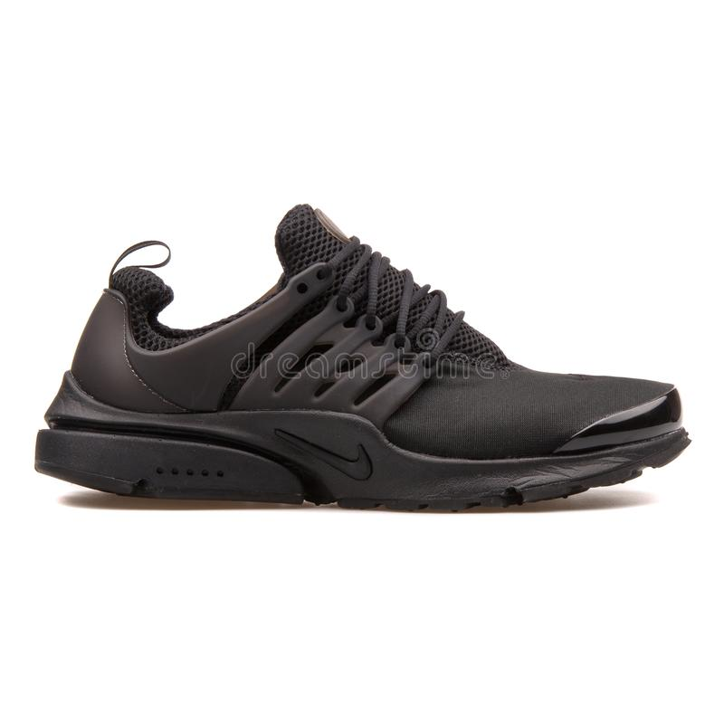 Scarpa da tennis del nero di Nike Air Presto fotografia stock