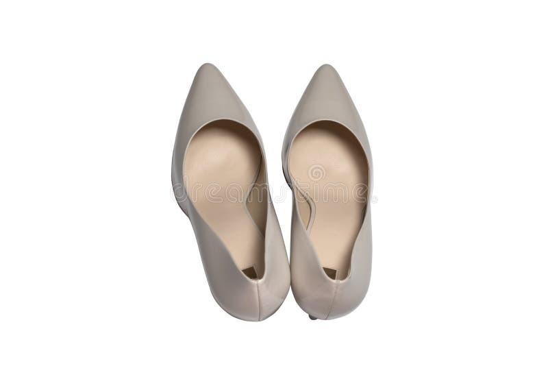 Scarpe di tallone eleganti su fondo bianco, vista dall'alto. Piatto fotografie stock libere da diritti