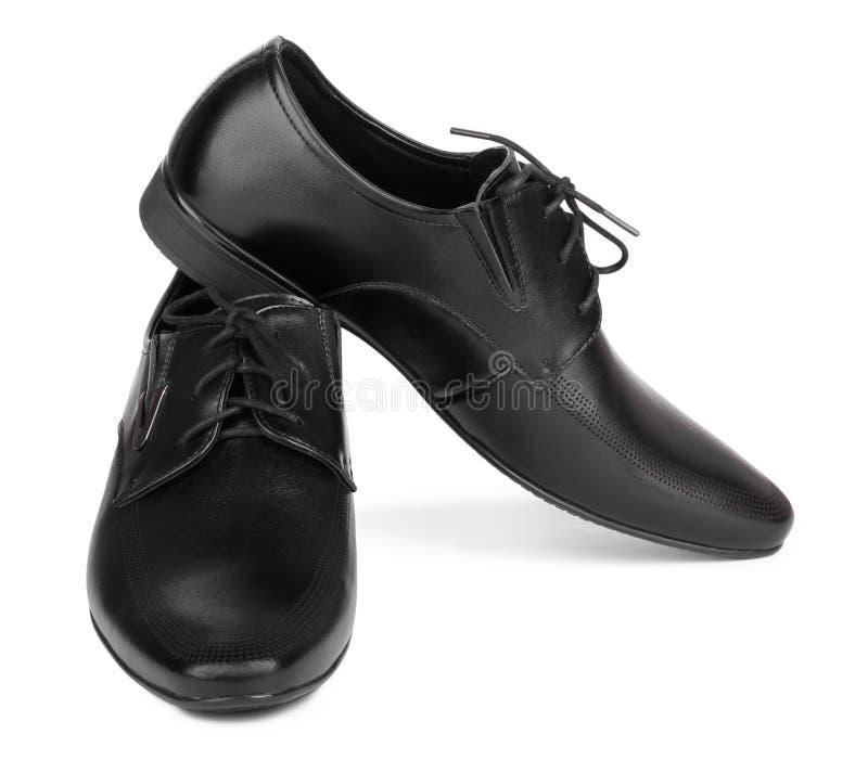 Scarpe eleganti nere del ` s degli uomini su fondo isolato fotografia stock libera da diritti