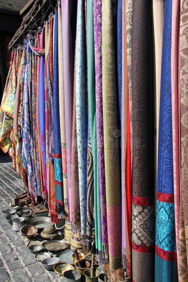 Free Scarves And Tableware In The Baku Market Stock Images - 136435714