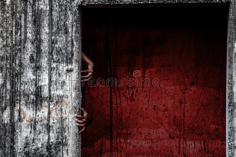 scary abandoned building with blood wall and ghost hand stock image