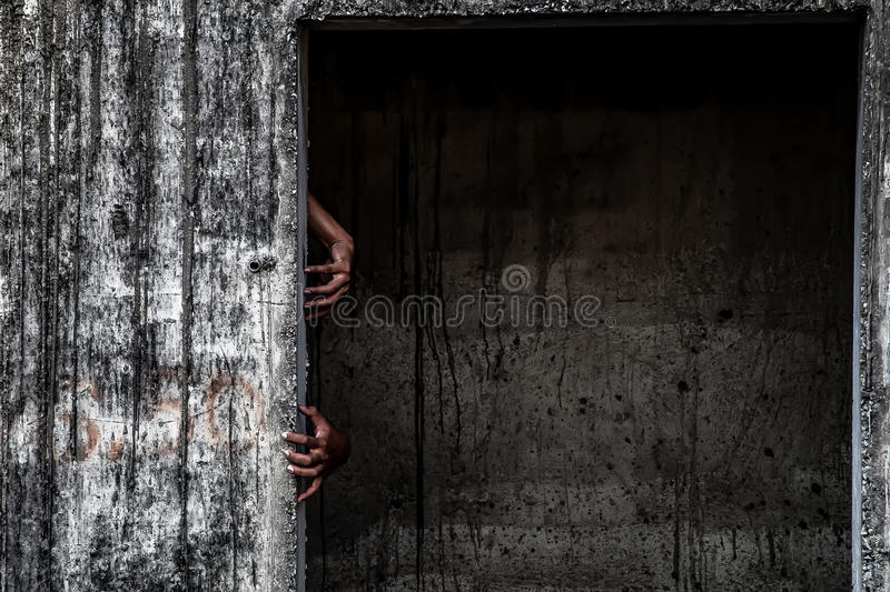 Download Scary Abandoned Building With Ghost Hand Coming Out Of A Door Stock Photo - Image & Scary Abandoned Building With Ghost Hand Coming Out Of A Door Stock ...